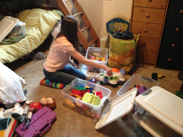 daughter trying to clean messy room